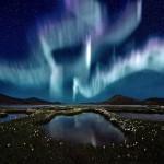 Northern Lights over a marsh landscape in Iceland